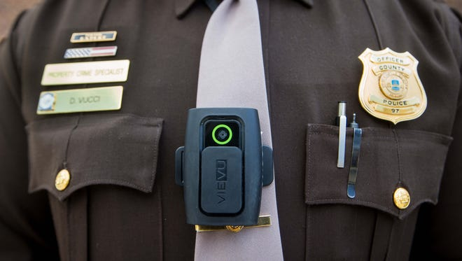 Officer 1st Class Daniel Vucci wears one of four different types of body cameras that New Castle County Police are testing on their officers as part of a pilot program.