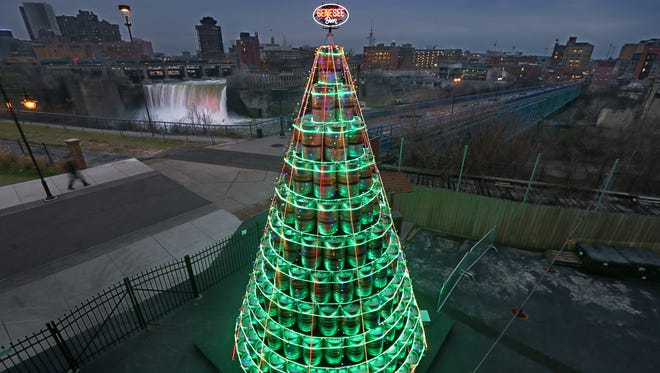 The lights are on and glowing on a 26-foot-high keg tree constructed outside the Genesee Brew House in downtown Rochester Friday, Dec. 4, 2015.  The Christmas tree is made up of 400 empty kegs.