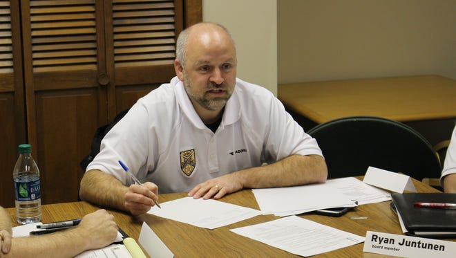 Delaware County Football Club president Chris Smith signs a friendly agreement with outside partner Adlai Chester on Feb. 16 to become the lone tenant of the building at 5450 North Wheeling Avenue, which was purchased Wednesday.