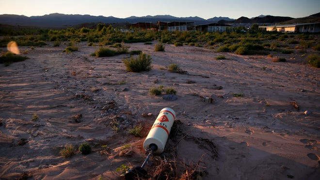 A buoy lies high and dry above the water line at the now defunct Echo Bay Marina in the Lake Mead National Recreation Area, Thursday, May 19, 2016, near Las Vegas. Lake Mead's surface is at its lowest level since the reservoir was created.