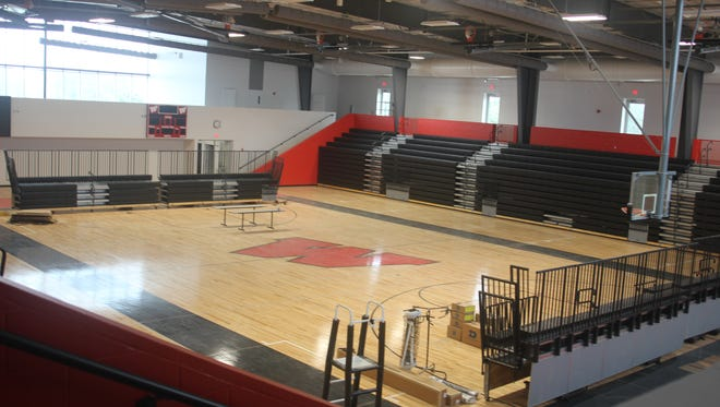The red and black theme of the Raiders are carried out in this spacious, 1,700-seat gymasium at Williamsburg High School. There's the big basketball court and ample seating and handicap access.