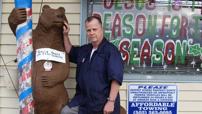 Larry Hayworth, owner of Larry's Family Barber on 3792 Silverton Road NE, was reunited with his bear statue on Sunday, Dec. 4, 2016.