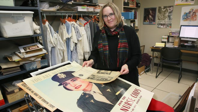 Anne Molineu, a volunteer from West Bend, is researching the history of items donated to the University of Wisconsin-Milwaukee Center for Nursing History.