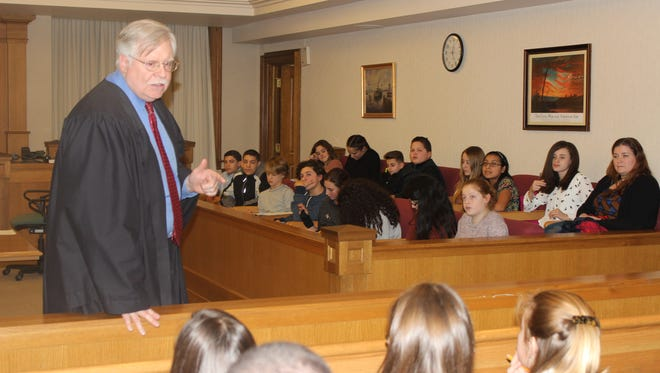 Dutchess County Court Judge Peter M. Forman  talks to seventh-grade students from Rombout Junior High School in Beacon during the Jan. 12 event.
