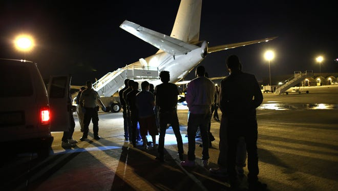 Undocumented immigrants wait to be loaded onto an Immigration and Customs Enforcement charter jet  in October 2015 in Mesa. President Donald Trump's executive order calls for deporting undocumented immigrants convicted of any crime.