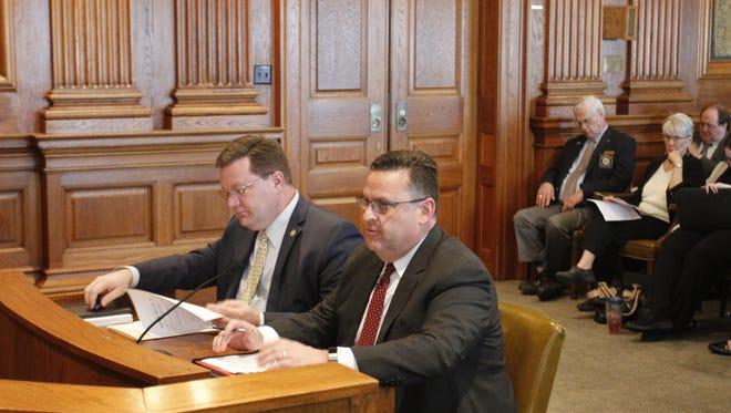 Attorney Kip Bilderback, right, testifies in support of a bill filed by Sen. Bob Dixon, left, R-Springfield, on Monday, Feb. 20, 2017, in Jefferson City.