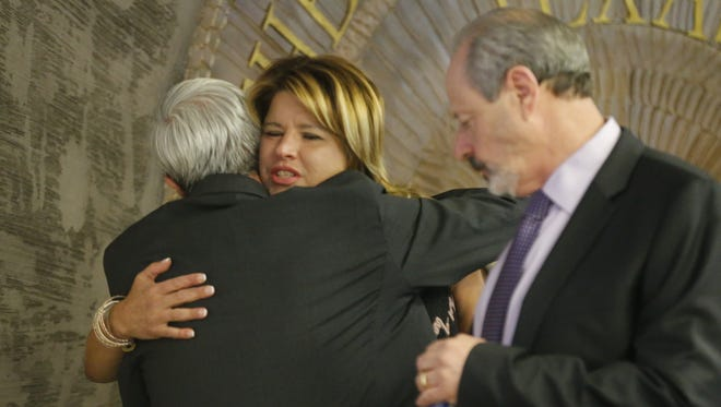 City Rep. Cortney Niland gets hugs from council members after announcing her resignation Tuesday afternoon.