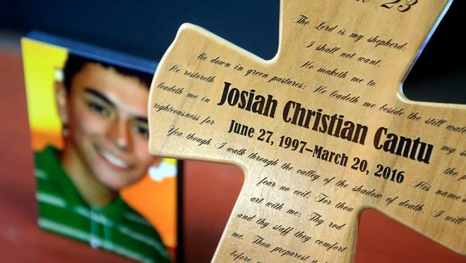 A cross with a prayers is displayed in honor of Josiah Christian Cantu after he died from a gun shot wound last year, on April 11, 2017, in Corpus Christi. Corpus Christi Police initially said Cantu shot himself, but ayear later Nieces County District Attorney Mark Gonzalez is seeking a criminal indictment against a friend.