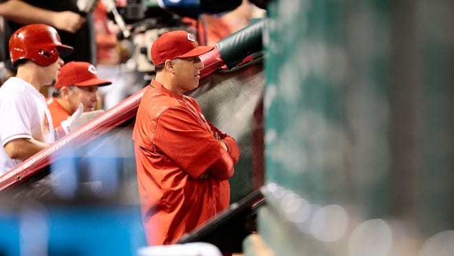Cincinnati Reds manager Bryan Price (38) watches from the dugout in the bottom of the sixth inning.