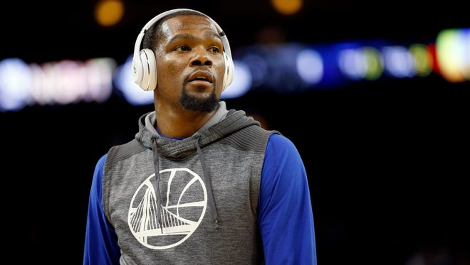 Golden State Warriors forward Kevin Durant (35) stands on the court before the start of a game against the New Orleans Pelicans at Oracle Arena.