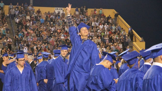Carlsbad High School graduate Waylon Mendoza acknowledge the crowd at Friday's commencement. Approximately 331 seniors graduated.