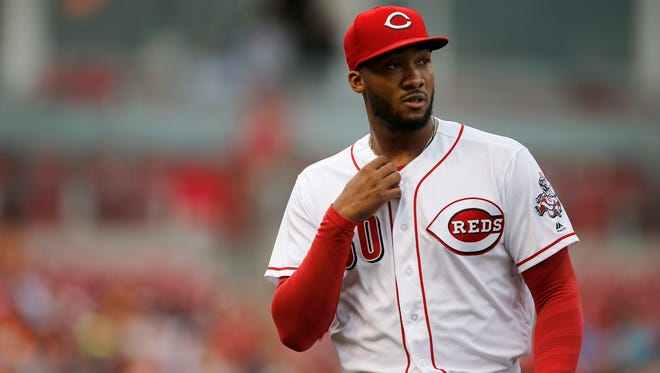 Cincinnati Reds starting pitcher Amir Garrett (50) walks to the dugout after the top of the first inning of the MLB interleague game between the Cincinnati Reds and the Cleveland Indians at Great American Ball Park in downtown Cincinnati on Tuesday, May 23, 2017. The Reds led the Indians 3-1 after two innings.