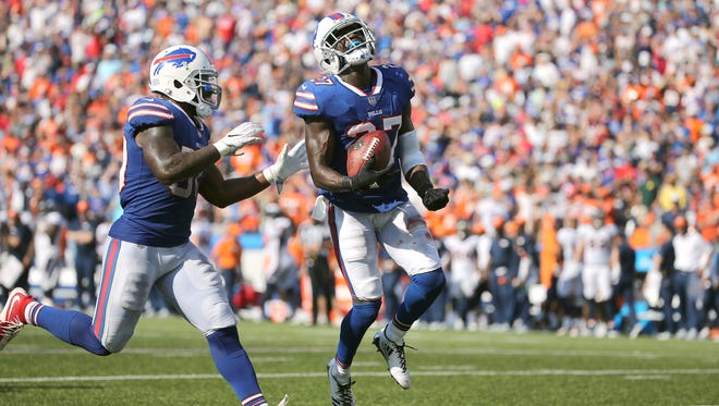 Bills cornerback Tre'Davious White celebrates with Ramon Humber after his interception against Denver.