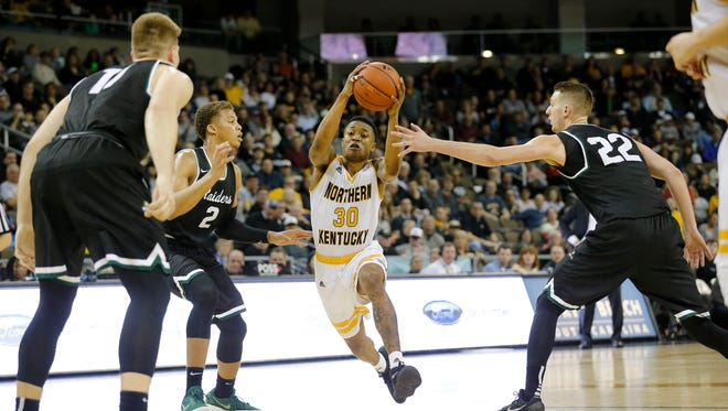 Northern Kentucky Norse guard Lavone Holland II (30) drives between defenders in the first half of the NCAA basketball game between the Northern Kentucky Norse and the Wright State Raiders at BB&T Arena in Highland Heights, Ky., on Thursday, Jan. 11, 2018.