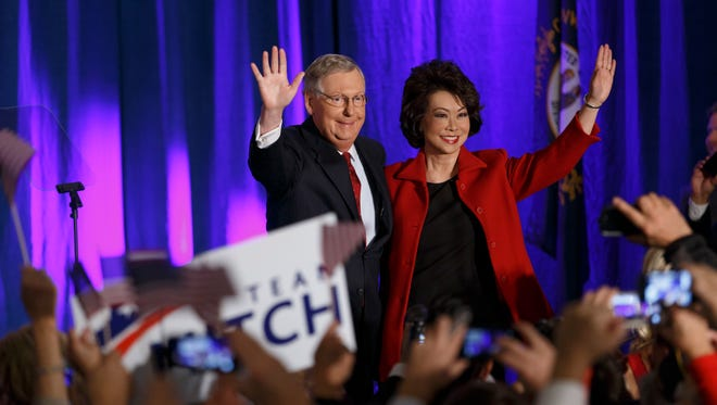 Senate Minority Leader Mitch McConnell, R- Ky.,  is joined by his wife, former Labor secretary Elaine Chao, on election night.