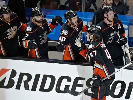 Anaheim Ducks defenseman Hampus Lindholm (47) celebrates after scoring against the Nashville Predators during the third period of Game 1 in the NHL hockey Stanley Cup Western Conference finals, Friday, May 12, 2017, in Anaheim, Calif. (AP Photo/Chris Carlson)