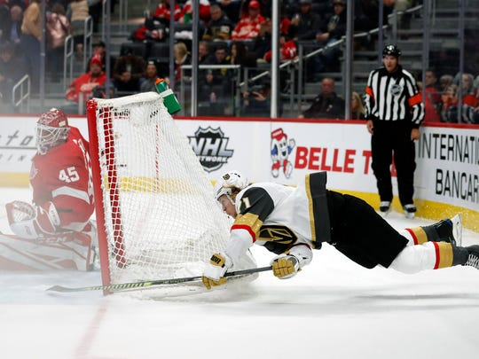Vegas Golden Knights center William Karlsson (71) attempts a shot against Detroit Red Wings goaltender Jonathan Bernier (45) during the second period of an NHL hockey game, Sunday, Nov. 10, 2019, in Detroit. (AP Photo/Carlos Osorio)