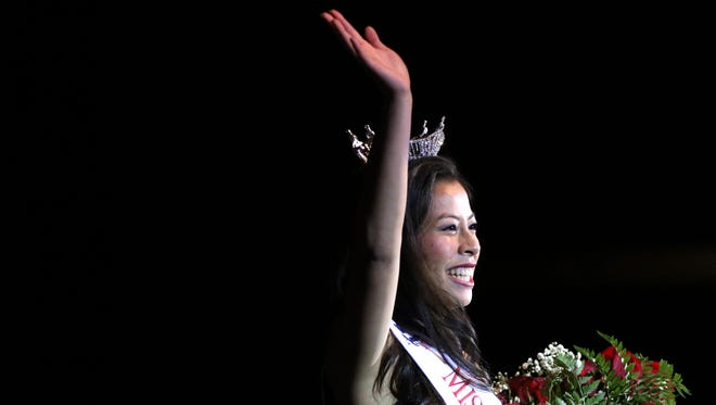 Ryann Swanson waves to the cheering crowd after being crowned Miss Wisconsin Rapids Area 2017 Saturday night.