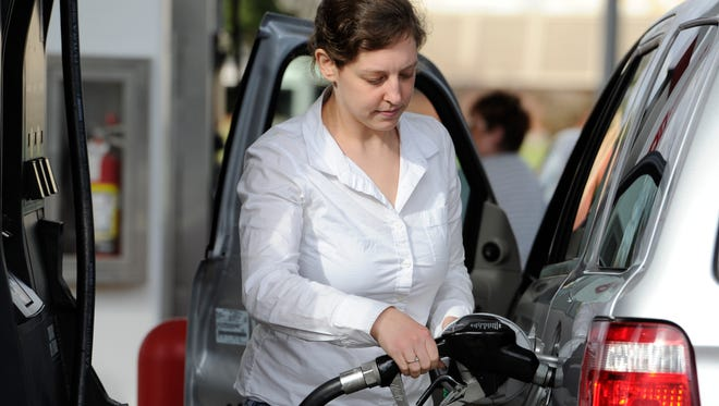 Rachel Schupack of Philadelphia pumps gas in this 2014 file photo