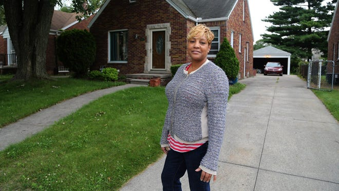 Joan Morris Buchanan paid $6,700 last year for her home on Lansdowne on Detroit's east side and has spent nearly $12,000 renovating it.