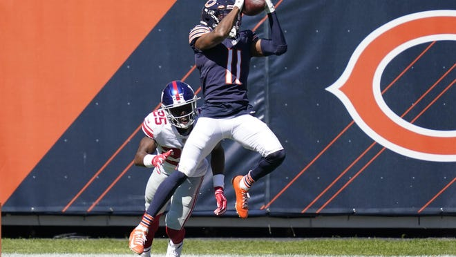 Chicago Bears wide receiver Darnell Mooney (11) catches a 15-yard touchdown pass as New York Giants cornerback Corey Ballentine (25) defends during the first half of an NFL football game in Chicago, Sunday, Sept. 20, 2020.