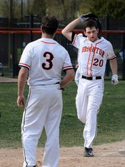 Brighton's Andrew Gilpin is greeted by teammate Kyle