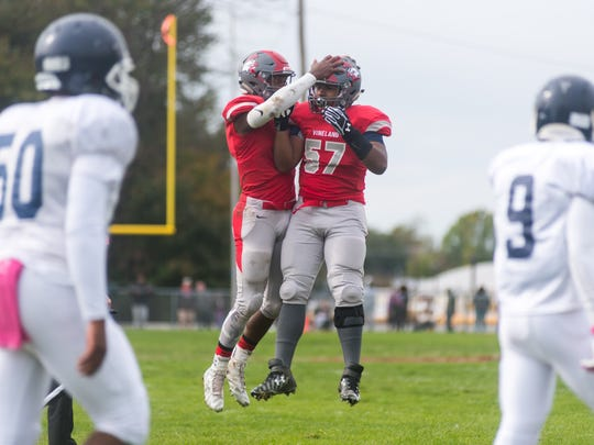 Vineland quarterback Isaih Pacheco (1) and tackle Timothy Jones (57) celebrate a touchdown against Atlantic City at Gittone Stadium on Saturday, October 22.