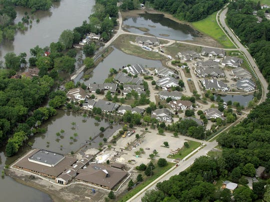 Floodwaters from the Iowa River leave a layer of mud behind as they recede from the Idyllwild and Taft Speedway neighborhoods, top, and Parkview Church in Iowa City on Tuesday, June 24, 2008.