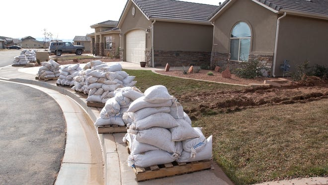 Sandbags sit on pallets waiting to be picked up outside homes in the River Shadow subdivision in Washington City in this Spectrum file photo.