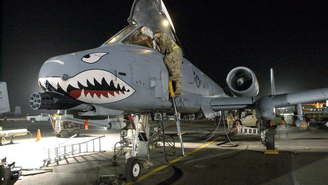 Air Force crews rearm, refuel and ready A-10 Warthogs.