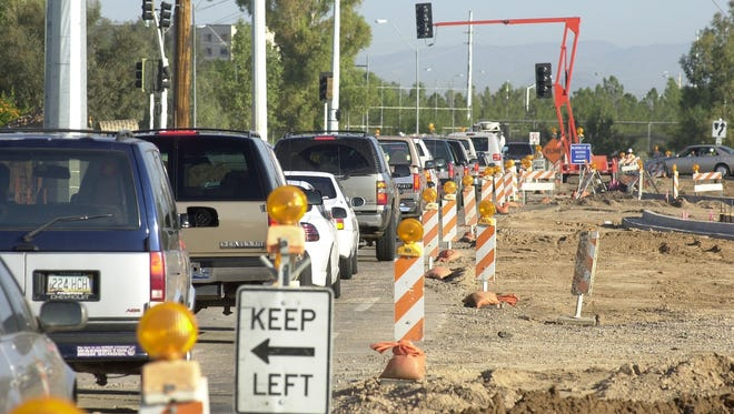 Traffic engineers in Scottsdale believe post-construction traffic can be solved by balancing green light time.