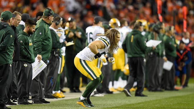 Green Bay Packers linebacker Clay Matthews (52) loosens up on the sidelines after getting hurt during Sunday night's game at Sports Authority Field in Denver, Colo. Photo by Evan Siegle/P-G Media