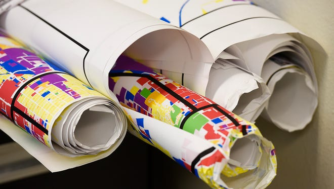 Rolls of maps shown in 2015 at St. Cloud Area Planning Organization's office.