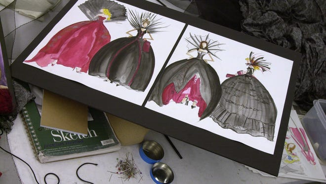 A file photo of sketches of ball gowns by a University of Cincinnati fashion design student. The fashion design school is mourning popular designer and lecturer Anthony Muto.