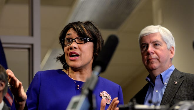 Governor Rick Snyder and Flint Mayor Karen Weaver meet with the press after a meeting to discuss the next steps in regards to Flint's water crisis Thursday, January 7, 2015, at the Romney Building in downtown Lansing.