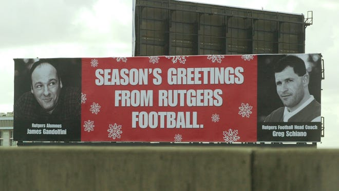 A billboard featuring Rutgers football coach Greg Schiano and Sopranos actor James Gandolfini was placed above a highway in Miami in 2001.