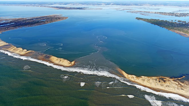 A winter storm over the weekend over Na. 22-24 carved a new inlet at the southern end of Assateague Island at Toms Cove.