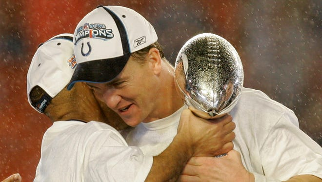 Indianapolis Colts quarterback Peyton Manning, right, embraces coach Tony Dungy following the Super Bowl XLI football game at Dolphin Stadium in Miami on Sunday, Feb. 4, 2007. The Colts beat the Chicago Bears 29-17.