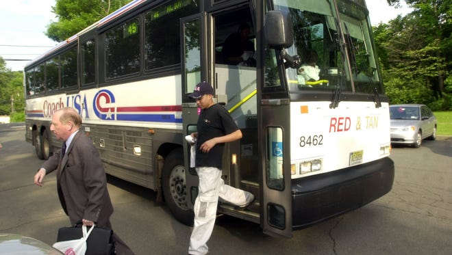 Passengers leave a Rockland Coaches bus. NJ Transit last week approved $100 million to buy more than 300 new buses, 64 of which will serve Rockland County.