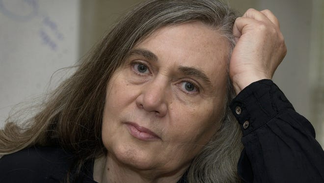 Author Marilynne Robinson speaks during an interview in 2004 in Iowa City.