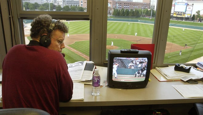 FILE – Indians' long-time broadcaster Howard Kellman in the broadcasting booth at Victory Field in 2005.