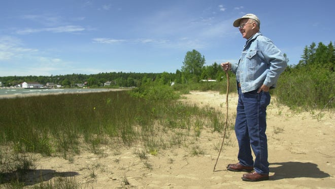 Naturalist Roy Lukes stands on the shoreline at the Ridges Sanctuary outside Baileys Harbor in 2000.