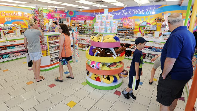 Customers check out Candy Kitchen in Rehoboth Beach on Thursday. Beach businesses are readying for a busy Independence Day holiday weekend.