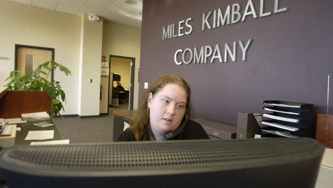 Miles Kimball Company, Oshkosh, WI, 11-02-05  Rachel Krummen of Human Resources of Miles Kimball Company works on the front desk at the company's new headquarter at City Center Wednesday.  City Center, one of Oshkosh's most successful TIFs, currently has 85 percent of occupancy.