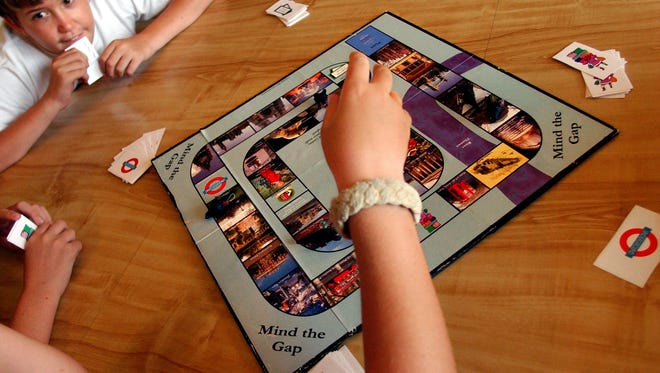 Sam Walker, 13, plans his next move during a session of  Mind the Gap, a board game created by Vero Beach resident Kelly Lufkin and her 10 year-old son, Colby.  The game is in production and may be distrubuted by national toy store chains. This image was originally used in Sept. 2003.