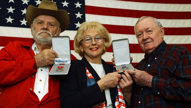 Former State Rep. Kay Katz, R-Monroe, an elector in the 2016 U.S. presidential election, poses with veterans in a file photo.