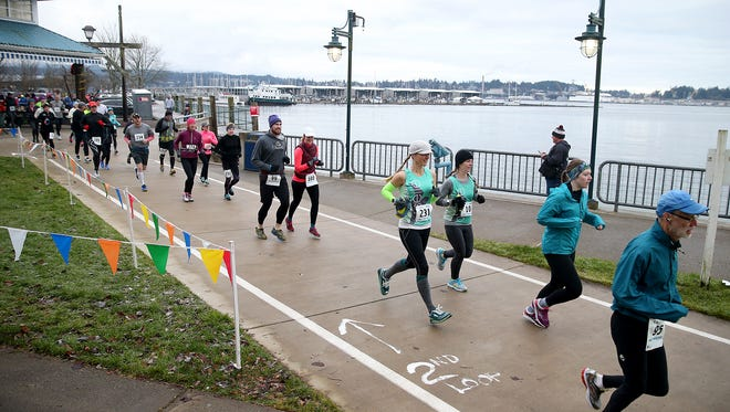 Yukon Do It! half marathon runners at the start at Marina Park in Port Orchard during a previous year of the race. This year's edition takes place on Sunday.