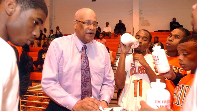 Legendary basketball coach Sylvester Ford Sr. does what he does best as he motivates his Fairley Bulldogs to a win over Hamilton High on Thursday, Dec. 18, 2008.