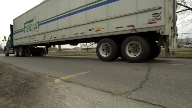 In 2002, one of the hundreds semis that travel every day to and from the DaimlerChrysler plant in Marysville drives along Huron Boulevard. City officials had said the trucks contributed to the deterioration of the road.