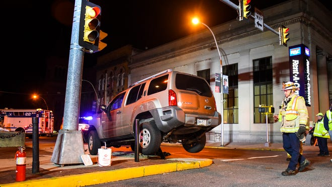 A Nissan Pathfinder driven by Zachary Young, 21, of Palmyra became stuck on a bollard at Ninth and Cumberland streets in Lebanon Tuesday night after colliding with another vehicle.